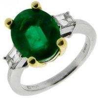 Oval Emerald Solitaire ring with Baguette Diamonds