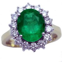 An Oval Emerald and diamond cluster ring