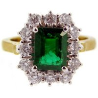 A traditional Emerald cluster ring brilliant cut diamonds