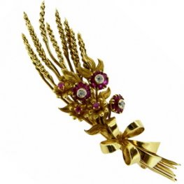 Golden wheat sheaf brooch with rubies and diamonds