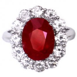 A White Gold Oval Ruby and Diamond Cluster Ring