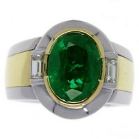 A Contemporary Oval Emerald and Diamond single stone ring