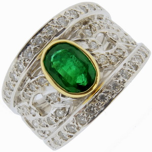 An Oval Emerald and Diamond Dress Ring. - Click Image to Close