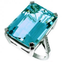 A Large Emerald Cut Aquamarine and Diamond Single Stone Ring