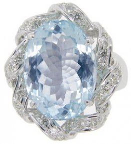 An Oval Aquamarine and Diamond cluster ring