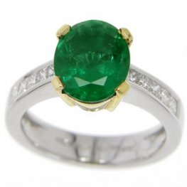 An Oval Emerald and Princess Cut Diamond Solitaire Ring