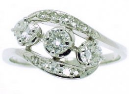 Brilliant Cut Diamond Three Stone Ring. Cross over design