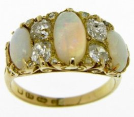 A Victorian Carved Opal and Diamond Ring