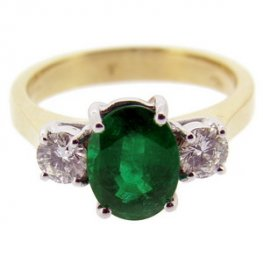A Stunning Oval Emerald and Diamond Ring