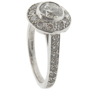 18ct white gold diamond halo cluster ring Half carat centre.