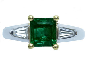 An Emerald-cut emerald and diamond ring